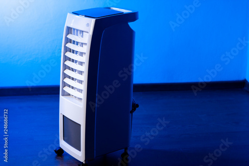 Obraz Outdoor air purifier. Air conditioning on wheels. Healthy work environment in the office. Air humidification with steam. - fototapety do salonu