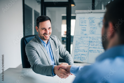 Welcome to the team. Business men handshake in the office. Canvas-taulu