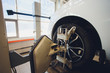 A Car on the Car Steering Wheel Balancer and Calibrate with laser reflector attach on each tire to center driving adjust in the garage.