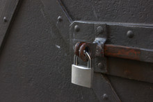 Silver Safety Lock On Black Iron Door