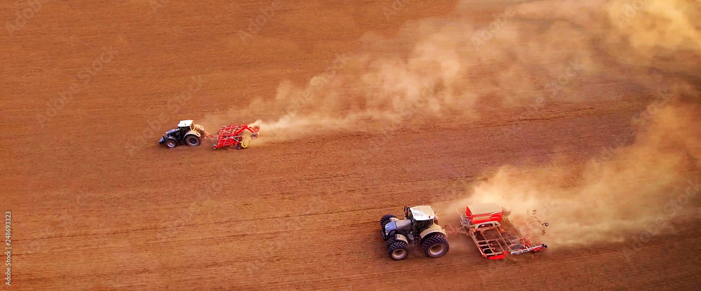 Fototapety, obrazy: aerial view of two agriculture tractors with plows. Plowing the field