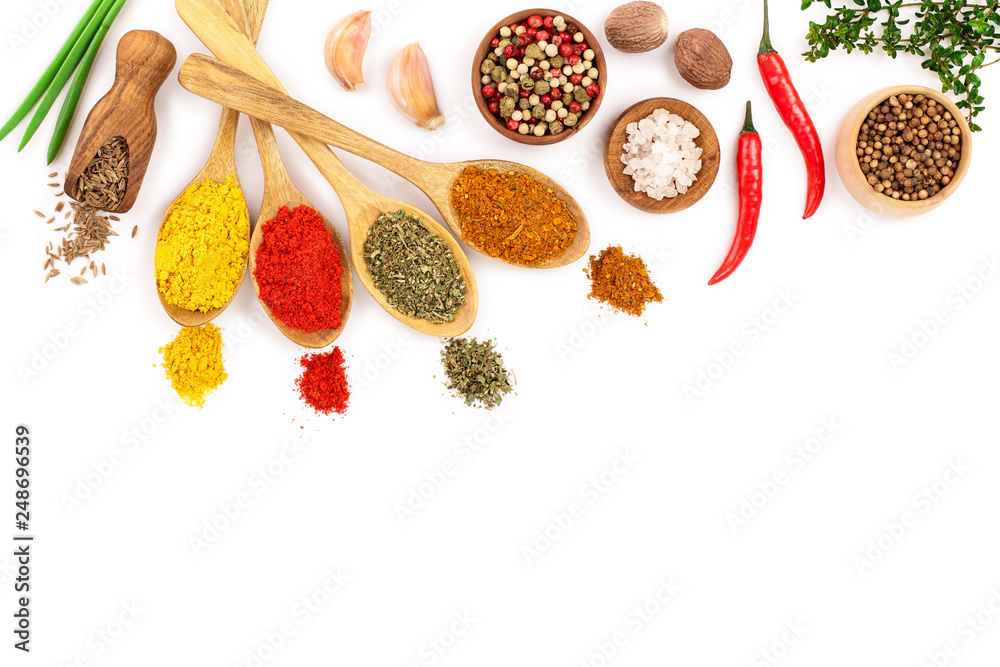 Fototapety, obrazy: mix of spices in wooden spoon isolated on a white background with copy space for your text. Top view. Flat lay. Set or collection