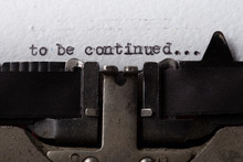 To Be Continued... Typed Words On A Old Vintage Typewriter. Close Up.