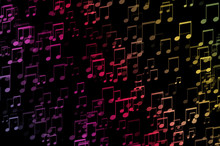 Rainbow Colored Musical Notes Isolated On Black Background.