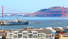 Iconic San Francisco Golden Gate Bridge, Famous Pier 39 Tourist District In The Foreground.