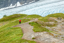 Hiker In A Red Jacket Hiking O...
