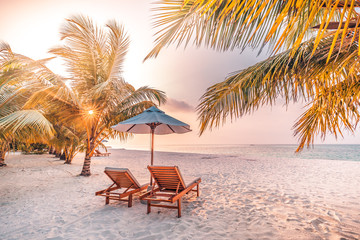 Beautiful beach. Chairs on the sandy beach near the sea. Summer holiday and vacation concept for tourism. Inspirational tropical landscape