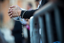 Rome Italy, June 18, 2017 : A Woman Prays The Rosary Before The Beginning Of The Celebration Of The Holy Mass Prior To The Corpus Domini Procession From St. John At The Lateran Basilica To St. Mary Ma