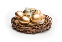 Nest With Golden Eggs On A Whi...