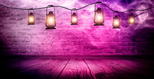 Magic Night Lantern. Night Lantern On The Background Of An Old Brick Wall, The Magic Glow Of The Lantern In The Dark, Wooden Floor.