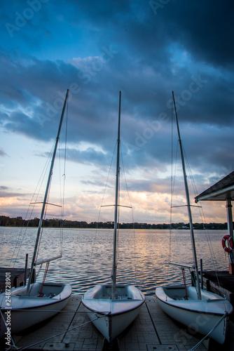 Photo  Boats at Dock at Sunset