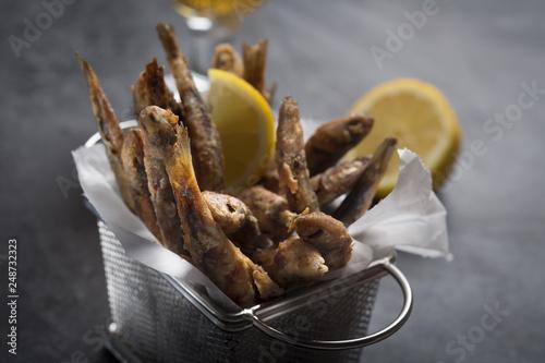 Fototapeta Seafood. Small sea fish, deep fried anchovies obraz