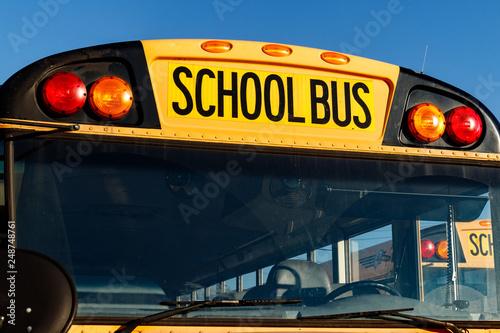 Fényképezés Cincinnati - Circa February 2019: Yellow School Buses in a District Lot Waiting