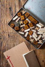 Vintage Box Of Rubber Stamps And Note Cards On A Wood Table