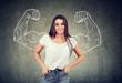 Leinwandbild Motiv Strong happy young woman flexing her muscles