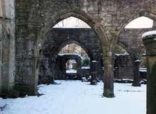 Arches And Columns In The Ruined Medieval Church In Hebden Bridge West Yorkshire With Snow Covering The Ground In Winter