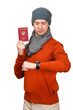 The Caucasian man with the international passport of the Russian Federation in warm clothes. Looks at the watch