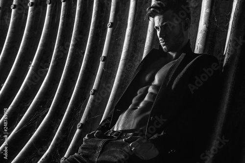 Fotografie, Tablou Muscular young man with beard on dark tunnel urban background