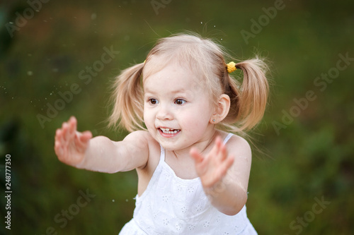 3f96c51cc Happy little girl playing in sunny park. Baby girl playing outdoor ...