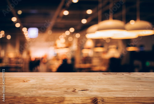 Spoed Foto op Canvas Restaurant Wood texture table top (counter bar) with blur light gold bokeh in cafe,restaurant background.For montage product display or design key visual