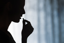 Medicine, Health Care And People Concept. Close Up Of Young Woman Taking In Pill