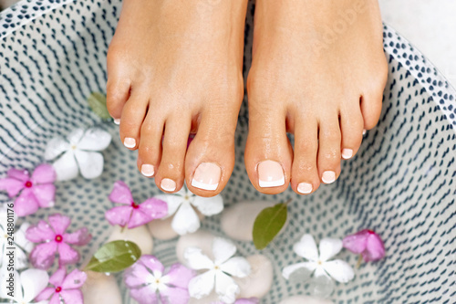 Well manicured and pedicured nails. Spa treatment and product for woman feet and foot spa.