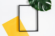 canvas print picture Summer composition. Tropical palm leaves, yellow paper blank, photo frame on pastel gray background. Summer concept. Flat lay, top view, copy space