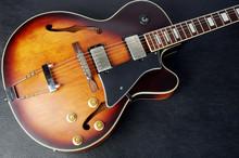 Jazz Guitar On A Dark Background. Close-up