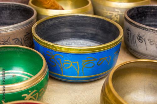 Fotografia  Tibetan Buddhist colored musical bowls