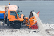 Machinery Snowplough Cleaning Highway By Removing Cleans Snow Swinging On The Side Of The Road