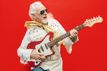 Senior Guitarist Playing His Favorite Rock'n'roll Song - Old Dressed Up Man Who Enjoys Playing The Guitar
