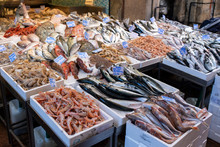 Fish And Seafood Stall In A Street Market In The Historic Center Of Bologna