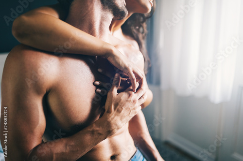 Fototapeta Young sexy hot couple in love hugging and kissing obraz