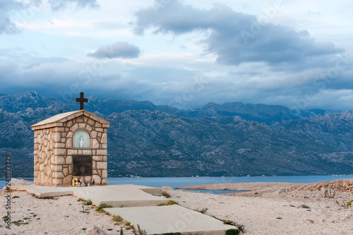 Fotografie, Obraz  Small chapel dedicated to Saint Mary on the island of Pag with Velebit mountains