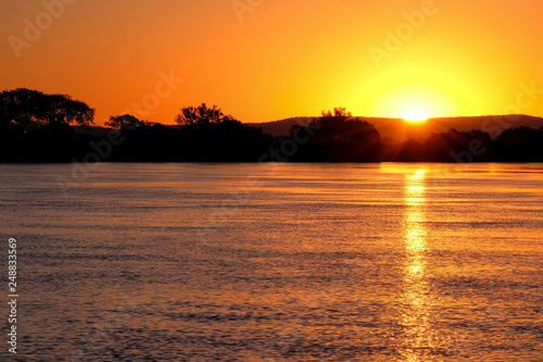 Fotografija  Paraguay River at sunset between Corumba and Porto Jofre, Pantanal, Mato Grosso