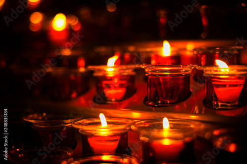 Fotografie, Obraz  place inside the church with burning candles