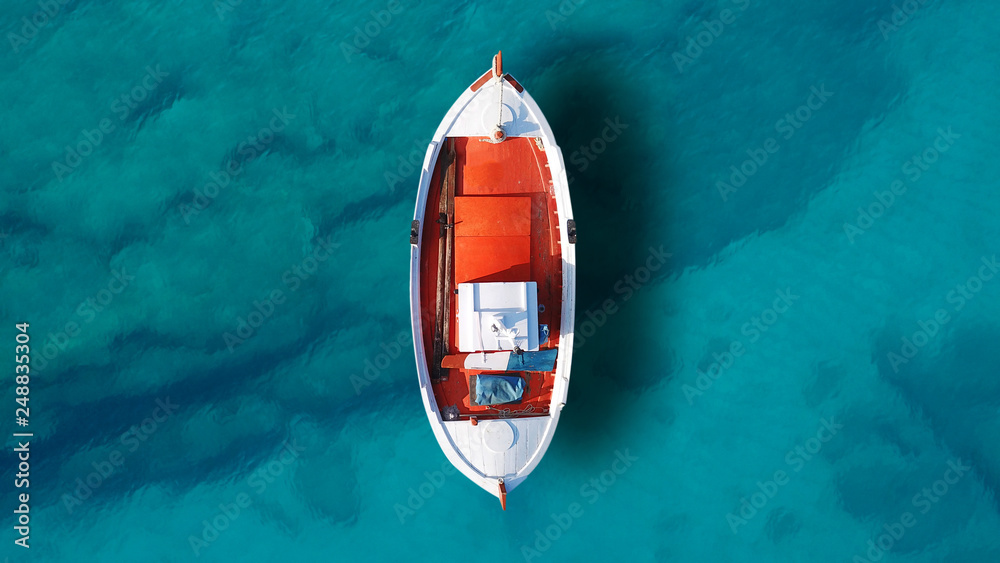 Fototapety, obrazy: Aerial drone top view photo of beautiful traditional fishing boat docked in clear waters of Koufonisi island port