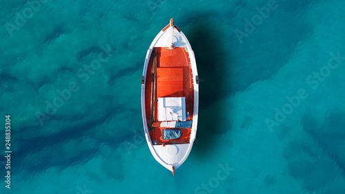 Obraz Aerial drone top view photo of beautiful traditional fishing boat docked in clear waters of Koufonisi island port - fototapety do salonu