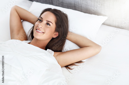 Fotografie, Obraz  Young beautiful woman waking up in her bed fully rested