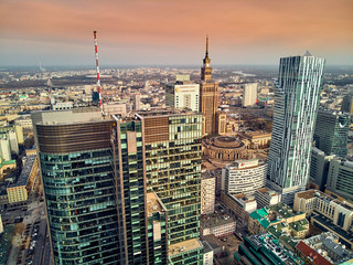 Obraz na Szkle Warszawa WARSAW, POLAND - FEBRUARY 10, 2019: Beautiful panoramic aerial drone view to panorama cityscape of Warsaw modern City, PKiN and