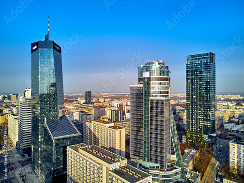 Fototapeta WARSAW, POLAND - FEBRUARY 10, 2019: Beautiful panoramic aerial drone view to panorama of Warsaw modern City, Q22 - neomodern office skyscraper designed by APA Kuryłowicz & Associates obraz