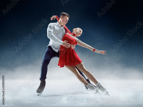 Obraz na plátně Professional man and woman figure skaters performing show or competition on ice