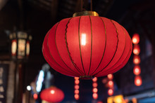 Group Of Red Chinese Lanterns Illuminated At Night For The Chinese New Year