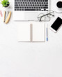 Stylized clean marble office working desk with smartphone, laptop, glasses and coffee, workspace design, mock up, topview, flatlay, copyspace, closeup