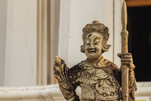 Cute Stone Of Chinese Arts Statue In Wat Suthat Temple, Bangkok, Thailand.