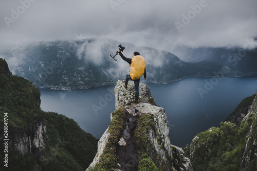 Vászonkép Outdoor & Nature Filmmaker on Mountaintop in Norway