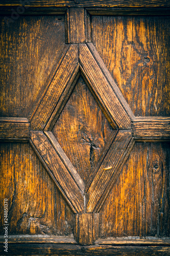 Leinwand Poster Detail on panel of old wooden door with diamond shape