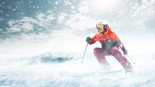 Young Beautiful Athlete Woman Doing Winter Sport - She Is Skiing Against White Alps Mountain Background