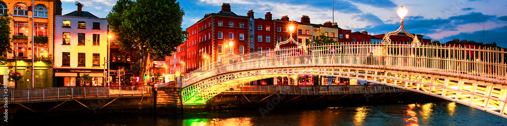 Fototapety, obrazy: Night view of famous illuminated Ha Penny Bridge in Dublin, Ireland at sunset