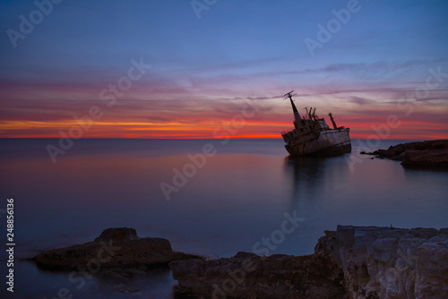 Foto auf AluDibond Schiffbruch Beautiful seascape and shipwreck. Abandoned ship Edro III at sunset near the Paphos, Cyprus.